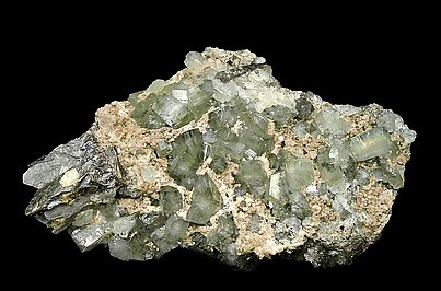 Fluorapatite with Siderite and Muscovite.