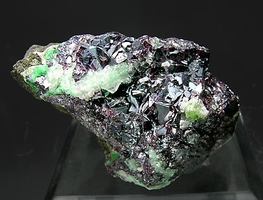 Cuprite with Calcite and Malachite.