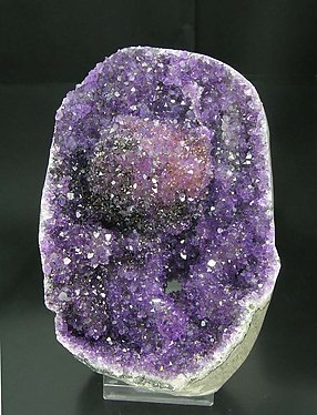 Calcite with Quartz (Amethyst) and Hematite.