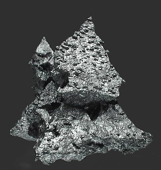 Acanthite with Pyrite and Calcite.
