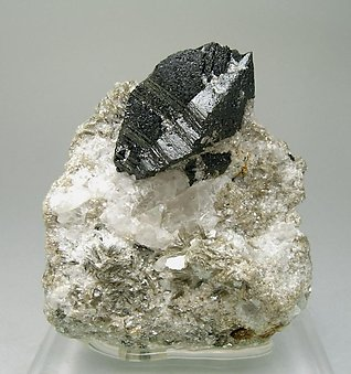 Cassiterite with Quartz and Muscovite.