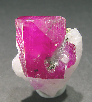 Corundum (variety ruby) with Calcite.