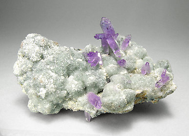 Quartz (variety amethyst) with Calcite.