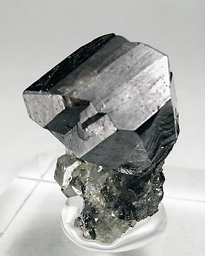 Cassiterite with Fluorapatite, Siderite and Quartz.