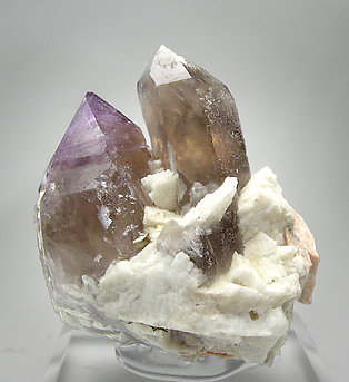 Quartz (variety amethyst) with smoky Quartz, Albite and Microcline. Front