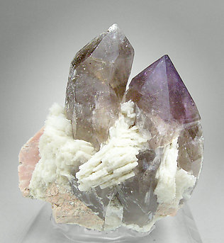 Quartz (variety amethyst) with smoky Quartz, Albite and Microcline. Rear