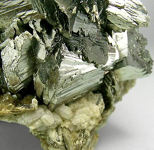Arsenopyrite with Topaz and Siderite.