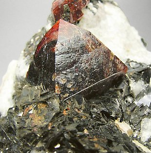 Zircon with Calcite and Muscovite.