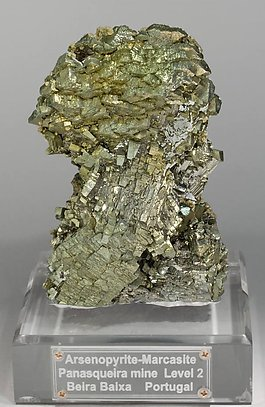 Epitactic Arsenopyrite-Marcasite with Calcite, Siderite and Chalcopyrite.