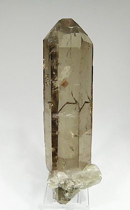 Quartz (variety smoky) with inclusions and Chlorite.