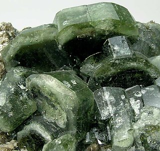 Fluorapatite with Muscovite, Quartz and Dolomite.