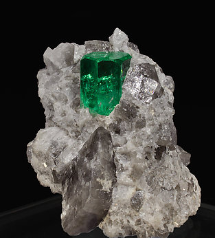 Beryl (variety emerald) on Calcite. side