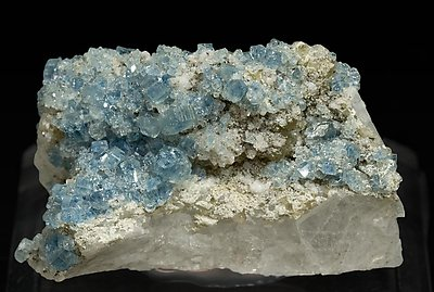 Fluorapatite with Bertrandite, Albite, Muscovite and Quartz.
