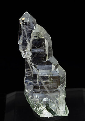 Quartz (variety faden) with inclusions.