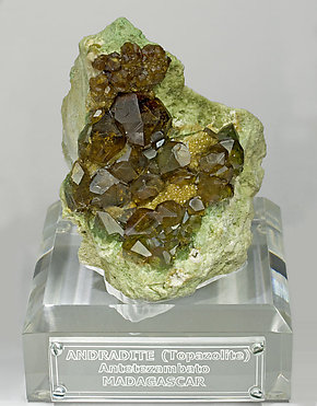 Andradite (variety topazolite) with Quartz. Front