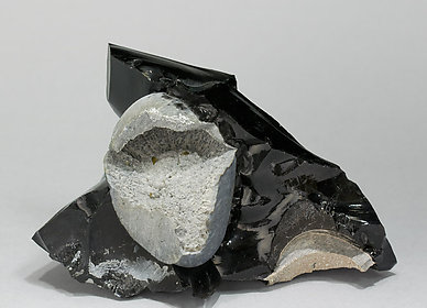 Cristobalite  with Tridymite and Fayalite on Obsidian.