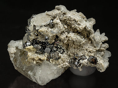 Cassiterite with Quartz, Dolomite and Tourmaline.