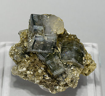 Fluorapatite, Quartz, Muscovite and Turmaline.