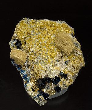 Whiteite-(CaFeMg) with Siderite, Lazulite and Quartz.