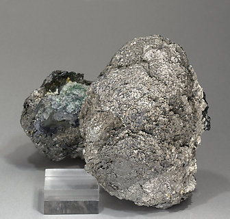 Löllingite with Magnetite and Calcite.