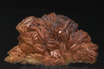 Baryte with inclusions of Hematite.