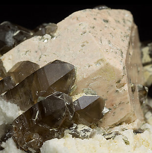 Microcline with smoky Quartz, Albite and Mica.