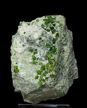 Andradite (variety demantoid) with Amphibole.