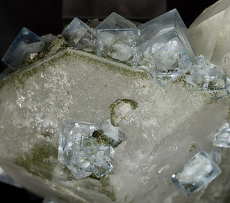 Quartz with Muscovite inclusions, Fluorite and Dolomite.