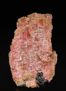 Rhodonite with Magnetite and manganoan Tremolite.