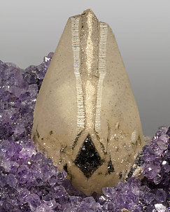 Quartz (variety amethyst) with Calcite and Hematite.