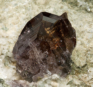 Axinite-(Fe) with Quartz and Calcite.