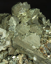 Epitactic Arsenopyrite-Marcasite with Siderite, Calcite and Muscovite.