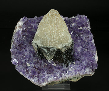 Calcite with Quartz (variety amethyst) and Hematite.