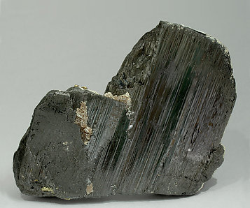 Ferberite with Muscovite, Calcite, Pyrite and Chalcopyrite. Front