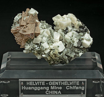Helvine-Genthelvite, Quartz and Calcite.