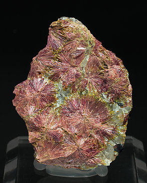 Clinozoisite (variety clinothulite) with Grossular and Quartz.