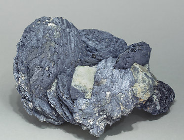 Löllingite with Molybdenite, Scheelite and Magnetite. Front