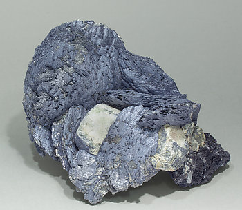 Löllingite with Molybdenite, Scheelite and Magnetite. Side
