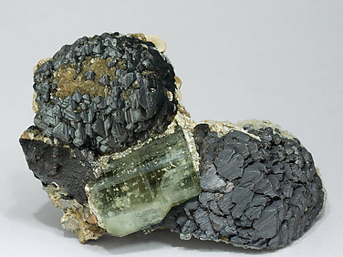 Fluorapatite with Sphalerite, Muscovite, Calcite, Siderite and Pyrite.