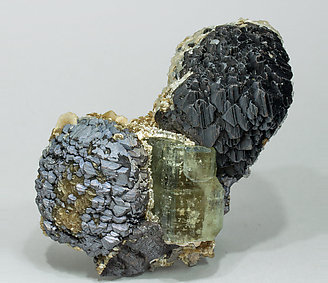 Fluorapatite with Sphalerite, Muscovite, Calcite, Siderite and Pyrite. Side