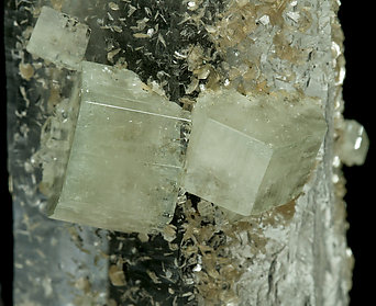 Quartz with Fluorapatite, Muscovite and Ferberite.