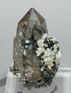 Bavenite with smoky Quartz, Chlorite and Garnet.