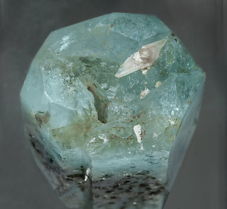 Beryl (variety aquamarine) with Muscovite and Quartz. Top