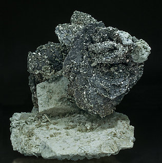 Löllingite with Molybdenite, Calcite, Arsenopyrite, Fluorite and Quartz. Side
