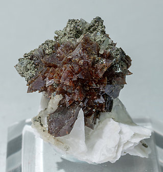 Helvine-Danalite with Calcite and Chlorite.
