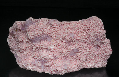 Rhodochrosite with Quartz (variety amethyst) and Helvine.