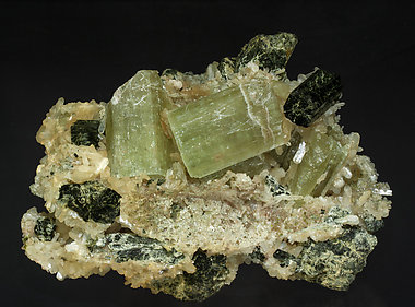 Fluorapatite with Stilbite-Ca and Arfvedsonite.