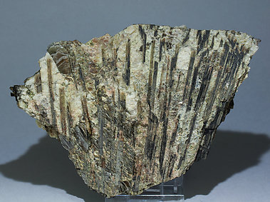 Allanite-(Ce) with Muscovite, Spessartine and perthite.