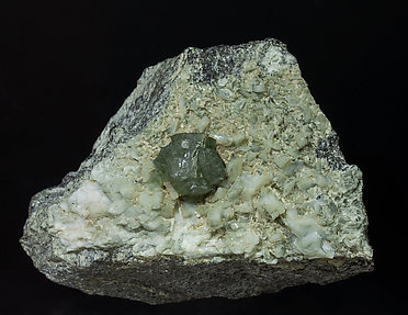 Prehnite with Orthoclase (variety adularia), Epidote and Amphibole.